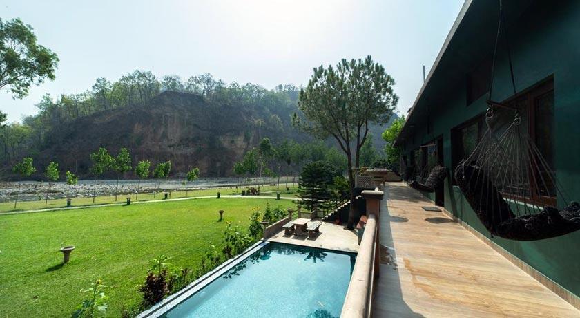 Swimming-in-Corbett-Riverside-Resort