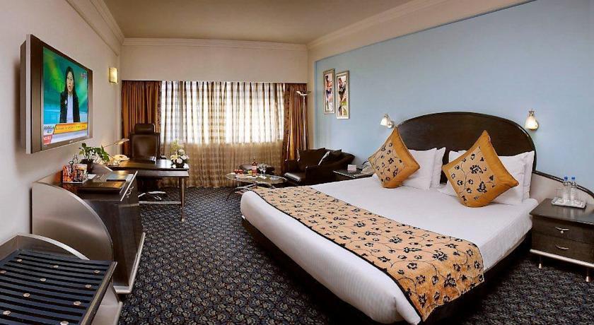 Deluxe room in The Suryaa, New Delhi