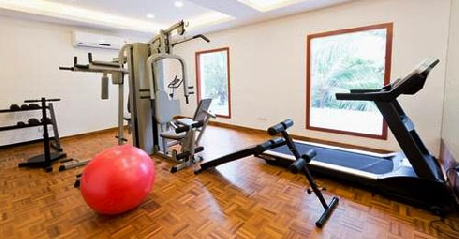 Gym in Golden Sun Hotel Beach Resort