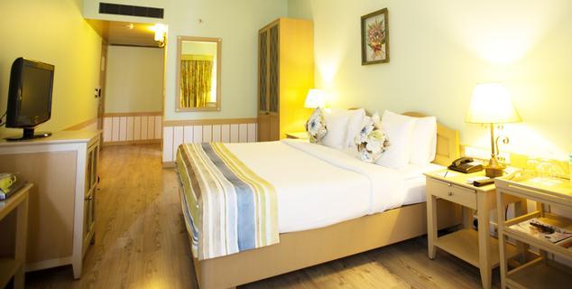 Bedroom in Gordon House Pune