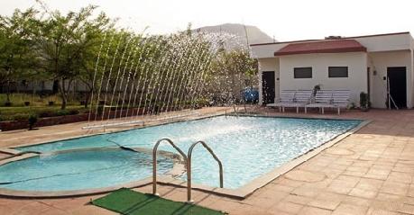 Swimming in Hotel Gulmohar Sariska Resort
