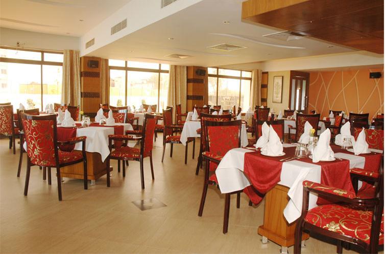 Dining in Hotel Aananda Imperial