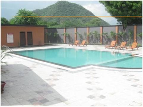 Swimming in Hotel Cambay Sapphire Neemrana