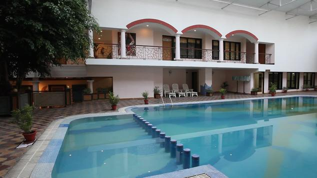 Swimming in Hotel Country Inn Bhimtal