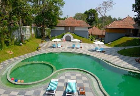Swimming in Hotel Elephant Court Periyar